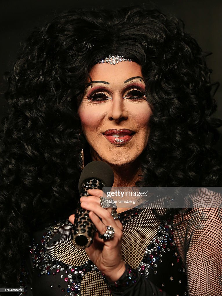 Cher impersonator Stephen Wayne from the show 'Divas' performs at the closing night party for the U.S. Travel Association's International Pow Wow at the Garden of the Gods Pool at Caesars Palace on June 12, 2013 in Las Vegas, Nevada.