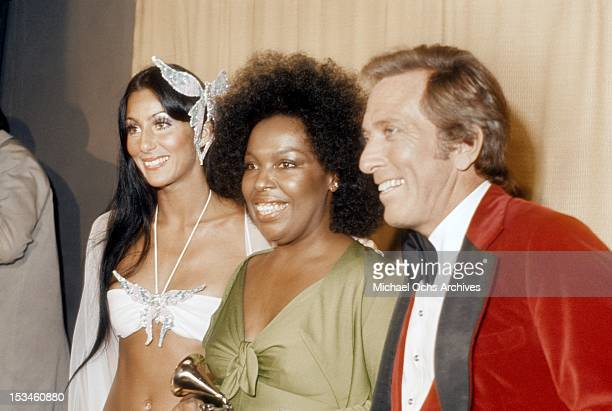 Cher Roberta Flack winner of Album of the Year for 'Killing me Softly With His Song' and host Andy Williams pose backstage at the 16th Annual Grammy...