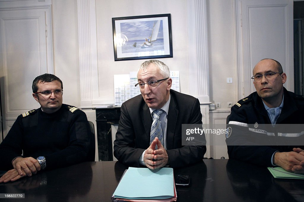 Cherbourg prosecutor Eric Bouillard (C) and deputy director of the territories and the sea Ronan Saout (L) give a press conference on December 13, 2012 about the Maartje Theadora, one of the world's largest trawlers in the northwestern French city of Cherbourg. The german fishing ship, suspected of violating fishing legislation, was rerouted to Cherbourg, and awaits for its fate to be decided.