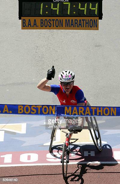 Cheri Blauwet of the US crosses the finish line to win the women's wheelchair divison of the 109th Boston Marathon with a time of 14745 April 18 2005...