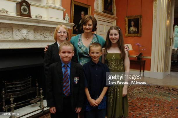 Cherie Blair meets Erica PotterLewis Michael Sykes Conor Howard and Chloe Metcalfe from Guildford for tea at No10 Downing Street in Central London
