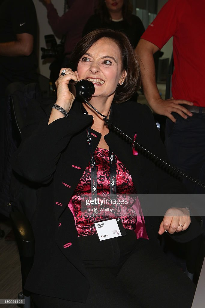 <a gi-track='captionPersonalityLinkClicked' href=/galleries/search?phrase=Cherie+Blair&family=editorial&specificpeople=158226 ng-click='$event.stopPropagation()'>Cherie Blair</a> speaks on the phone on the trading floor during the BGC Charity Day 2013 at BGC Partners on September 11, 2013 in London, England.