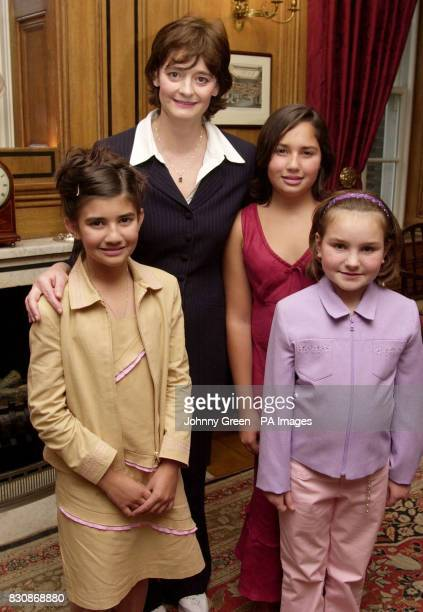 Cherie Blair stands with Alice Maddocks MollyAnn Barnett and Chloe Maddocks all from Alice Rose at a tea party at No 10 Downing Street in central...