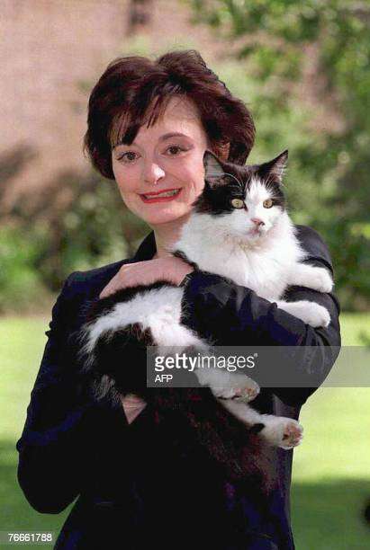 Cherie Blair wife of former British prime minister Tony Blair poses with Humphrey the cat 09 May 1997 in the garden of 10 Downing Street in London...