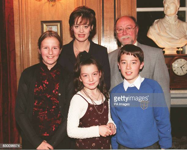 Cherie Blair wife of Prime Minister Tony Blair and Jim Dobbin MP for Heywood and Middleton with local children from his constituency Natasha...