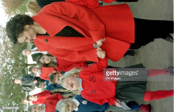 Cherie Blair wife of the Prime Minister Tony Blair holds the hand of sixyearold Rachel Hally as she leaves Dunblane Primary School in Scotland today...