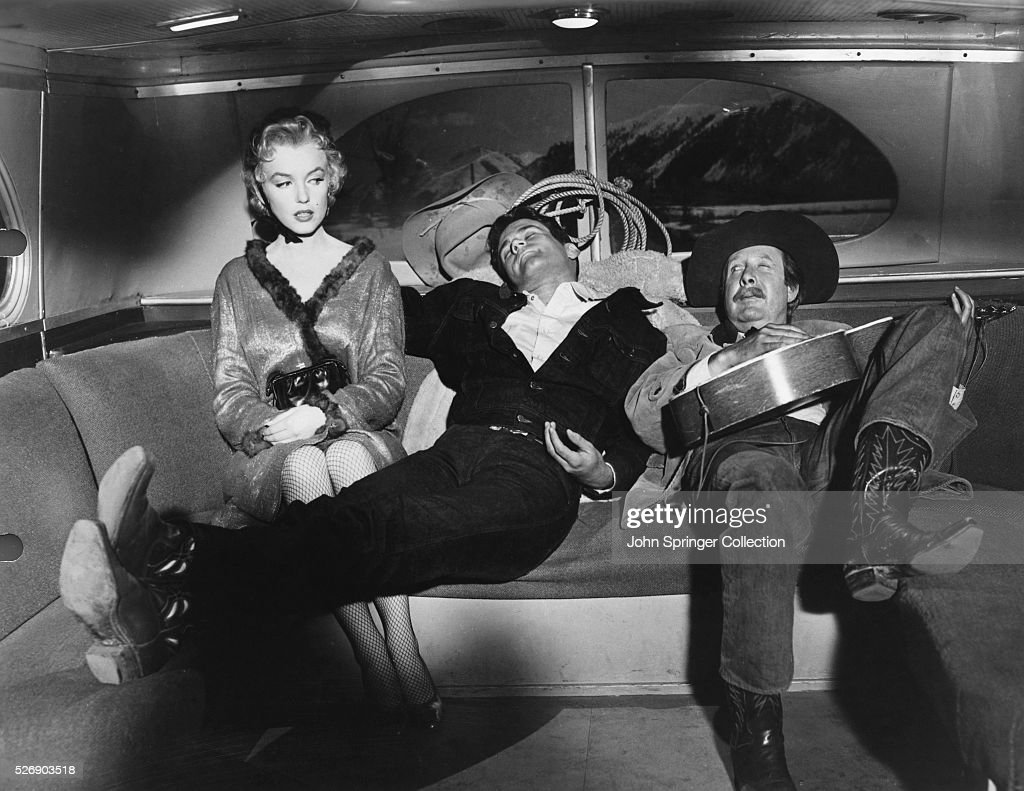 Cherie (Marilyn Monroe), Bo Decker (Don Murray), and Virgil Blessing (Arthur O'Connell) ride a bus during a scene from the 1956 film Bus Stop.