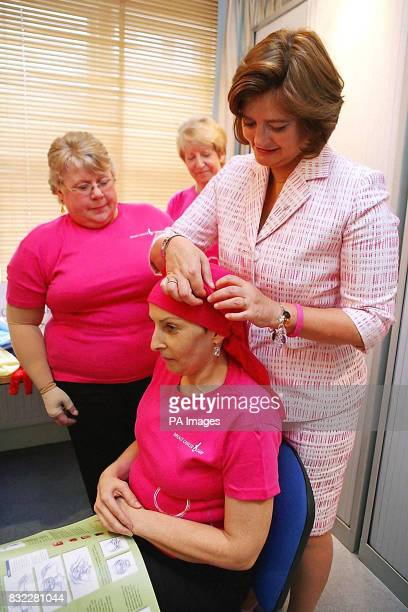 Cherie Booth wife of British Prime Minister Tony Blair and Patron of Breast Cancer Care ties a head scarf for cancer patient Jacqueline James as...