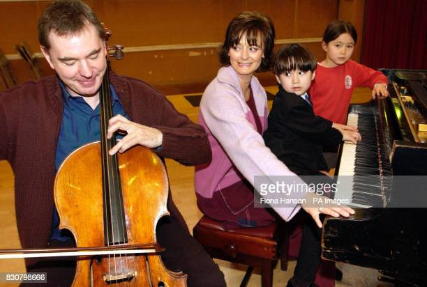Cherie Booth wife of Prime Minister Tony Blair played Chopsticks on the piano helped by cellist Julian Lloyd Webber and pianist Luke Van Brugen and...