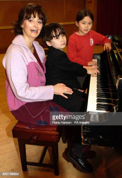 Cherie Booth wife of Prime Minister Tony Blair played Chopsticks on the piano helped by pianist Luke Van Brugen and violinist Olivia FanBarrett at...