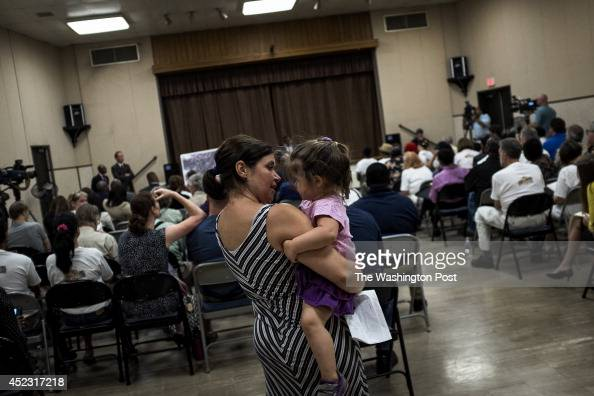 Cherie Cullen and her daughter Kayla attend a meeting to discuss options to save their home and the neighborhood of Piscataway Hills at Harmony Hall...
