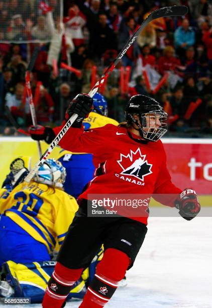 Cherie Piper of Canada celebrates her second period goal to make the score 30 in front of goalie Kim Martin of Sweden during the final of the women's...