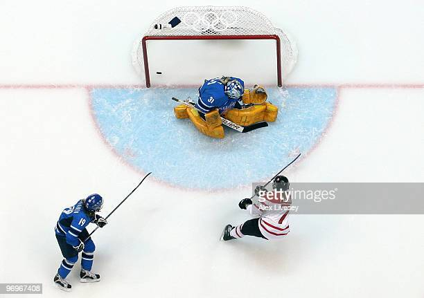 Cherie Piper of Canada scores a goal past Noora Raty of Finland in the first period during the ice hockey women's semifinal game on day 11 of the...