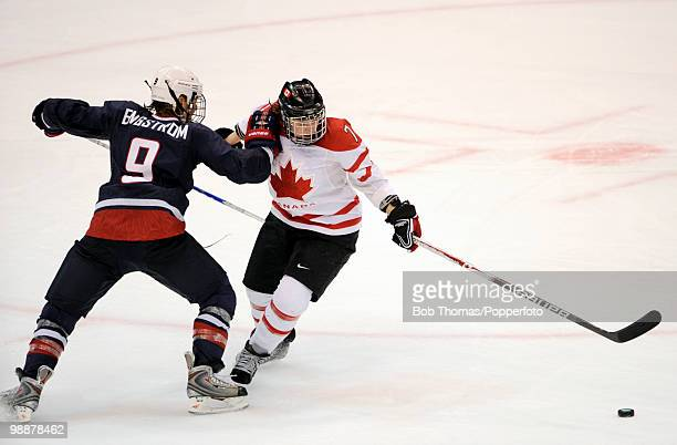 Cherie Piper of Canada with Molly Engstrom of the USA during the ice hockey women's gold medal game between Canada and the USA on day 14 of the...