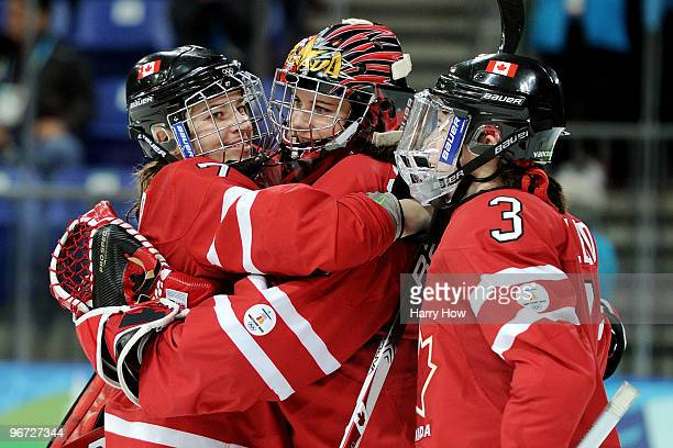 Cherie Piper Shannon Szabados and Carla Macleod of Canada celebrate after defeating Switzerland during the Women's preliminary game on day 4 of the...