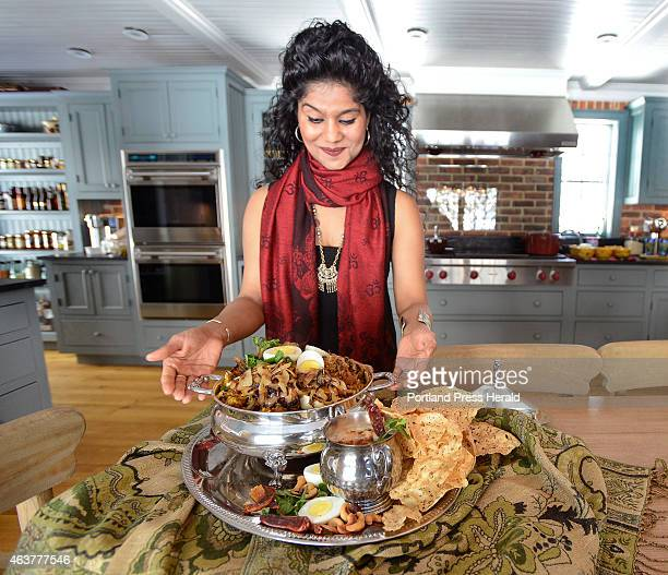 Cherie Scott displays a finished lamb biryani in the kitchen of her home in Boothbay