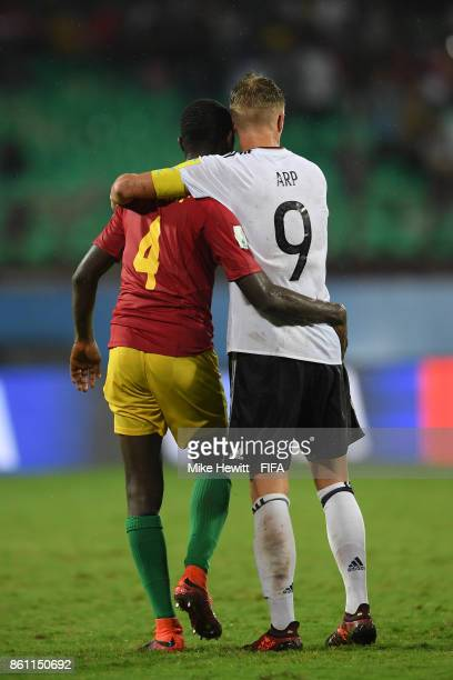 Cherif Camara of Guinea and JannFiete Arp of Germany embrace at the end of the FIFA U17 World Cup India 2017 group C match between Guinea and Germany...
