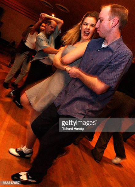 Cherilyn Hayres left flashes a smile as she and Dan Bruns throw in a little 'east coast swing' as they jitterbug at the The Derby recently in Los...
