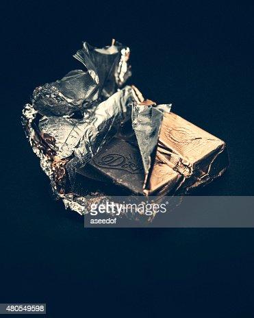 Acalento a minha última peça de chocolate : Foto de stock