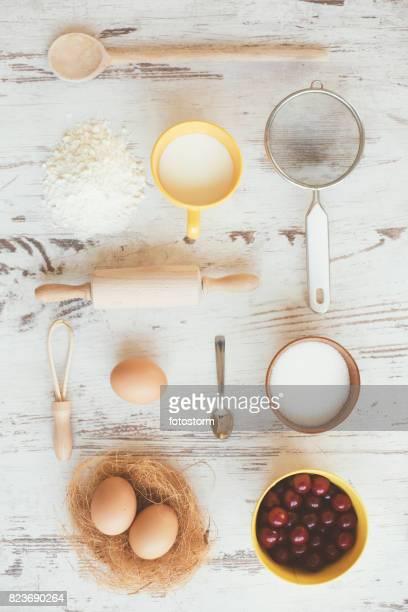 Cherries and kitchen utensils - knolling