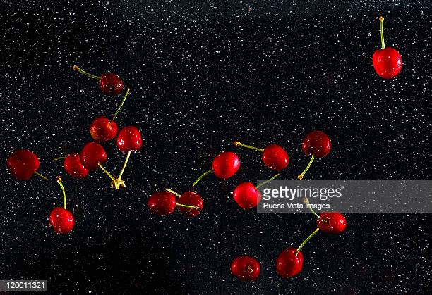 Cherries splashing in water