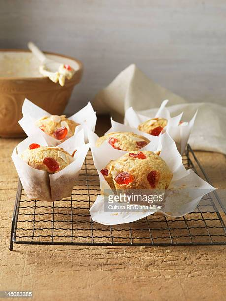 Cherry almond muffins on cooling rack