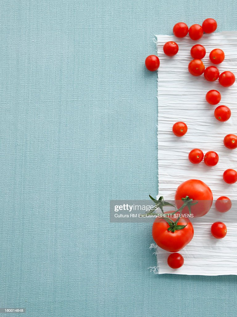 Cherry and vine tomatoes on table : Stock Photo