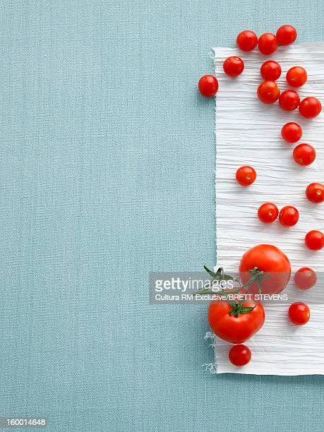 Cherry and vine tomatoes on table