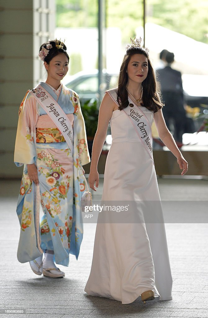 US Cherry Blossom Queen Mary Anne Morgan (R) from Oklahoma and Japan's Cherry Blossom Queen Chiori Kobayashi (L) arrive at the prime minister's official residence for a courtesy call on Japanese Prime Minister Shinzo Abe in Tokyo on May 28, 2013. Morgan won the title in April and is serving as a goodwill ambassador to Japan.