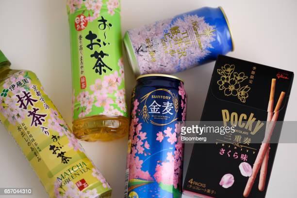 Cherry blossom themed products including Ito En Ltd's Oi Ocha green tea left and second left Suntory Beer Ltd's Kinmugi brand happoshu center bottom...