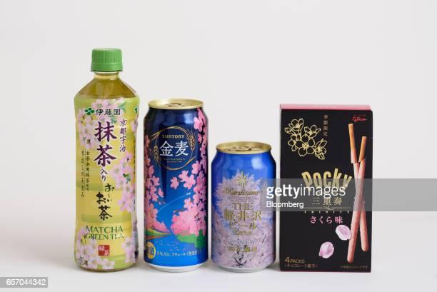 Cherry blossom themed products including Ito En Ltd's Oi Ocha green tea from left Suntory Beer Ltd's Kinmugi brand happoshu Karuizawa Brewery Ltd's...