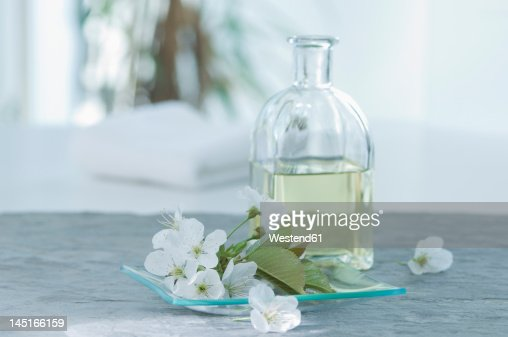 Cherry blossom with aroma oil, close up