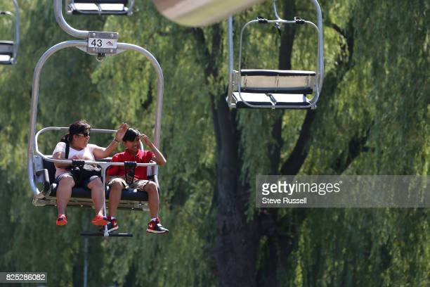TORONTO ON AUGUST 1 Cherry Cabildo shares a ride with her son Marc Toronto Islands have reopened to the public just in time for the first hot spell...