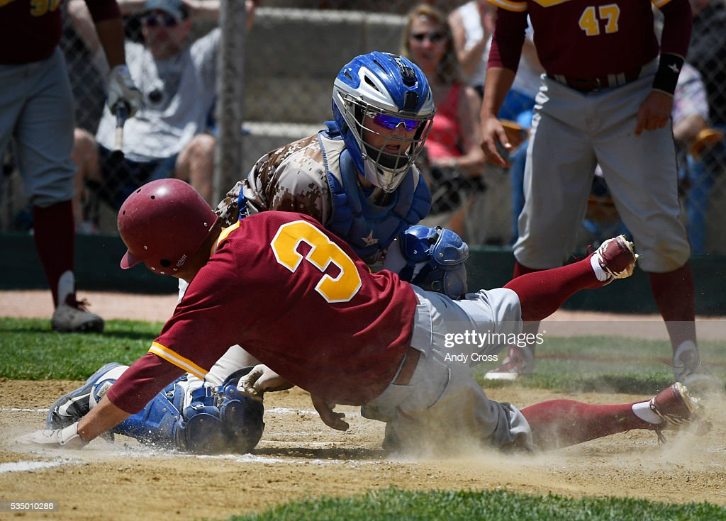 Cherry Creek catcher Andrew Chavez, #9, tags out Jadon Uhrich, #3, Rocky Mountain in the first inning of play during the Colorado 5A State Championship semi-final game at All-City Field May 28, 2016. Rocky Mountain went on to win 17-4.