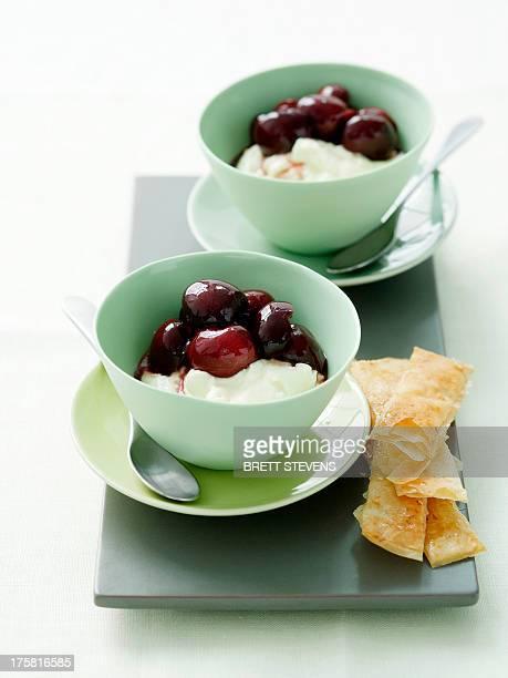 Cherry dessert in bowls with lemon crisps