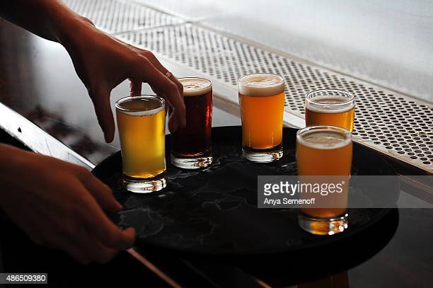 Cherry Hagens organizes a tasting tray of beer at Launch Pad Brewery on August 28 in Aurora Colorado Launch Pad Brewery opened in July