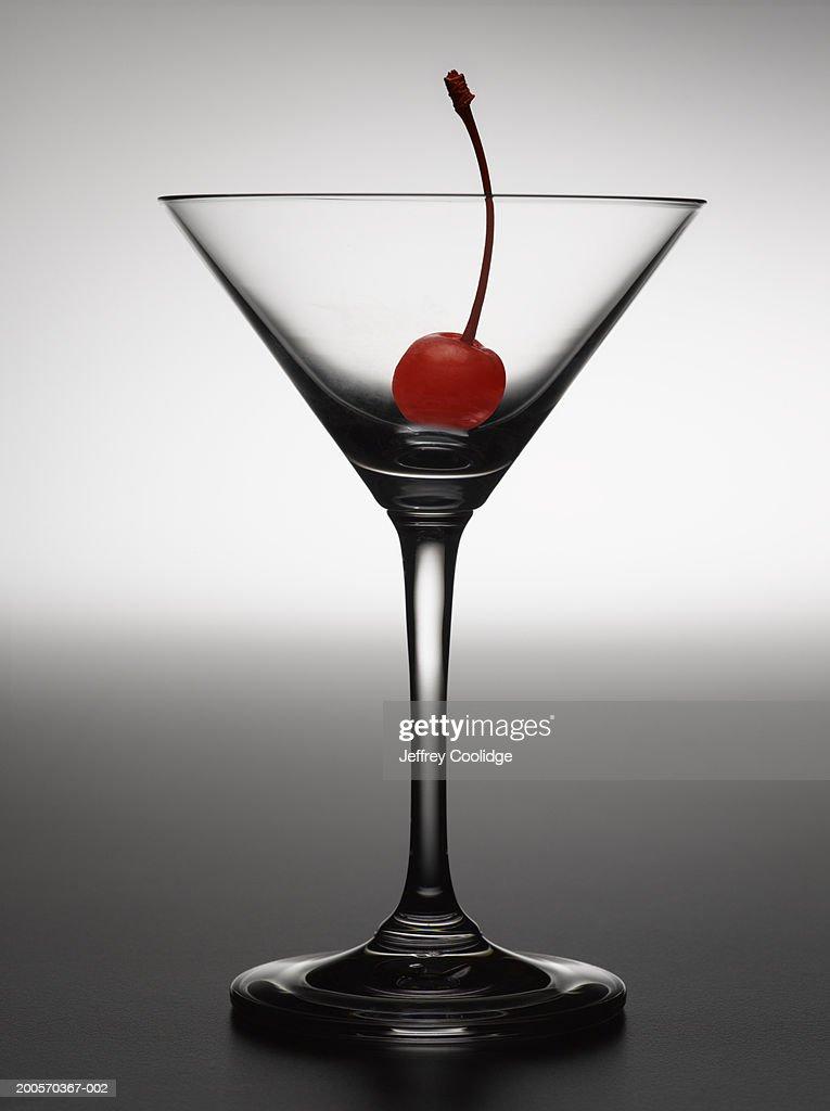 Cherry in empty martini glass : Stock Photo