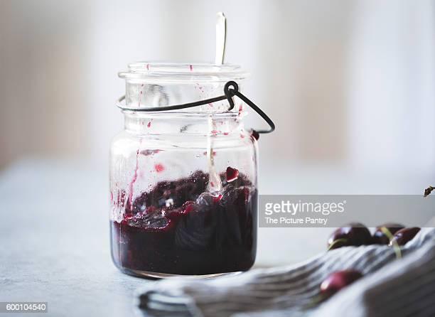 Cherry jam in a vintage jar