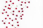 Cherry pattern. Fresh sweet cherry on white background. Flat lay, top view, copy space