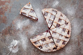 Sliced cherry lattice pie. Top view, blank space, vintage toned image