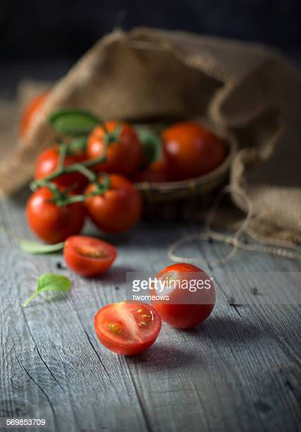 Cherry tomato in rustic kitchen table.