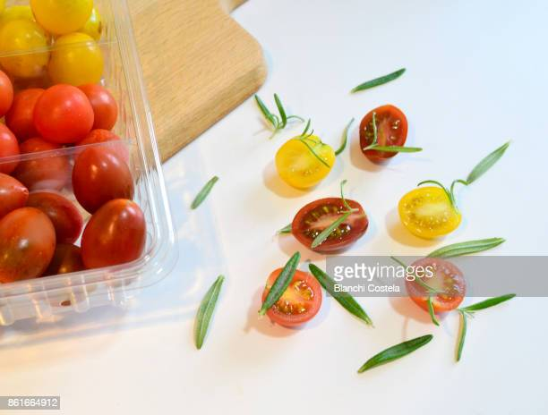 Cherry tomatoes of different colors on a table