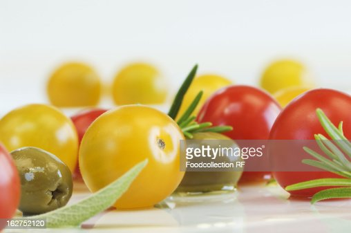 Cherry tomatoes, olives, sage and rosemary : Stock Photo