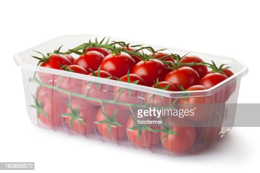Cherry tomatoes on a branch in retail packaging : Stock Photo