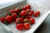 Cherry tomatoes in a white bowl
