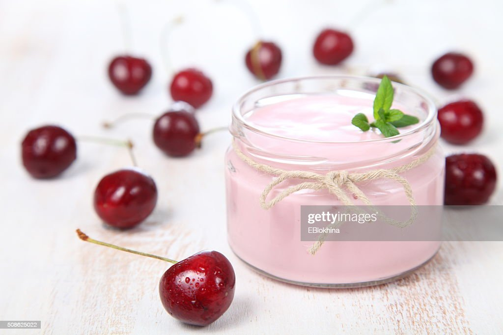 Cherry yogurt and ripe cherry : Stock Photo
