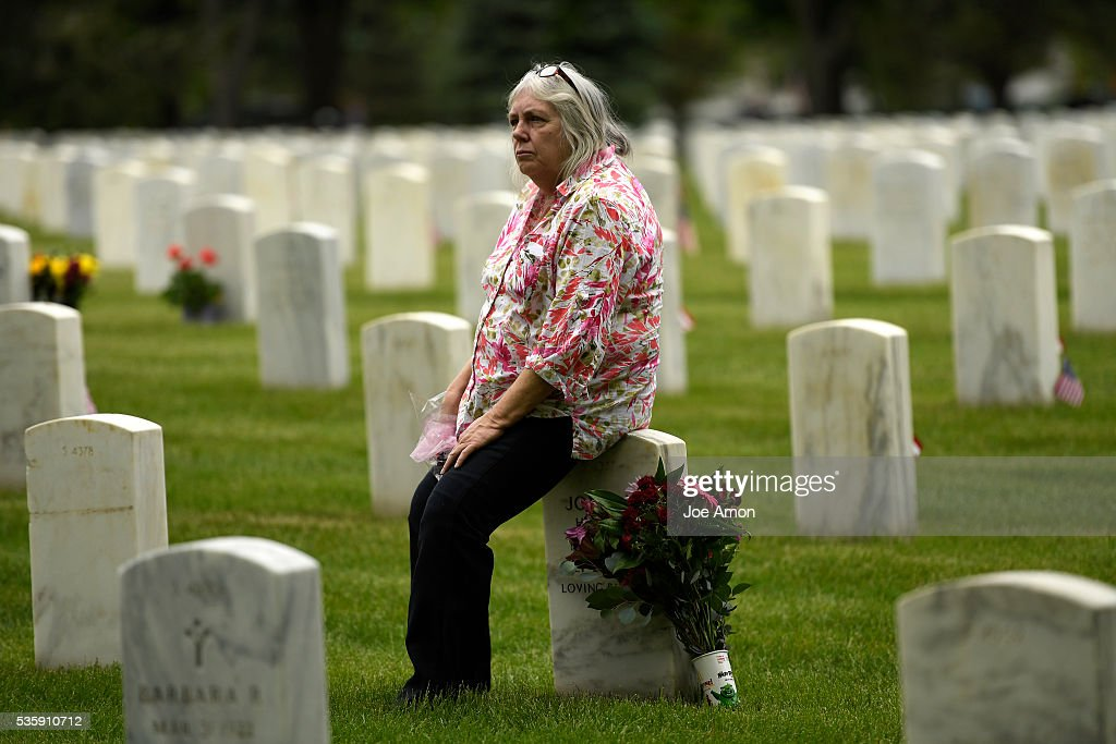 Cherryl Crowley visits the graves of her parents Joyce and Army PFC. Edger Sater who fought in WWII after the Memorial Day ceremony, 84th Anniversary of Remembrance at Fort Logan National Cemetery. May 30, 2016 in Denver, CO.