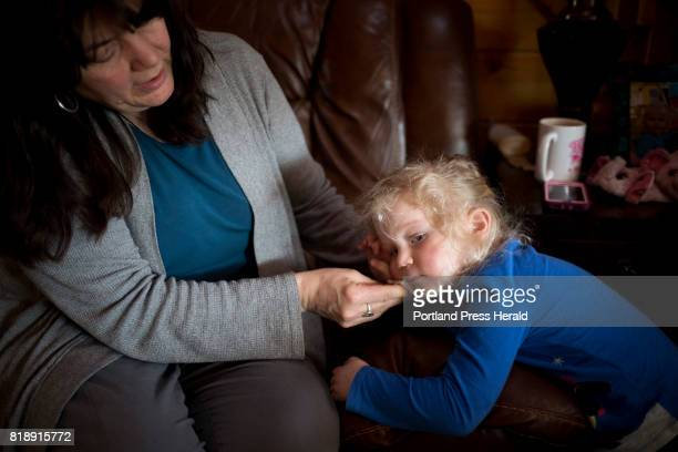Cheryl Baker cleans her granddaughter Claire's face after lunch The Bakers have been the primary caregivers to Claire since her mother their daughter...