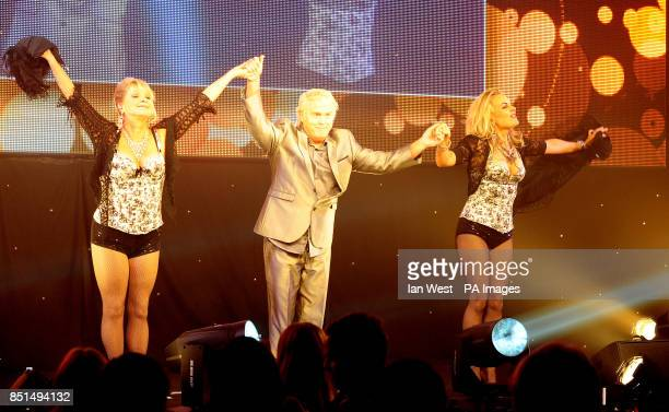 Cheryl Baker Mike Nolan and Jay Aston of Bucks Fizz perform at the Arqiva Commercial Radio Awards held at the Westminster Bridge Park Plaza Hotel...