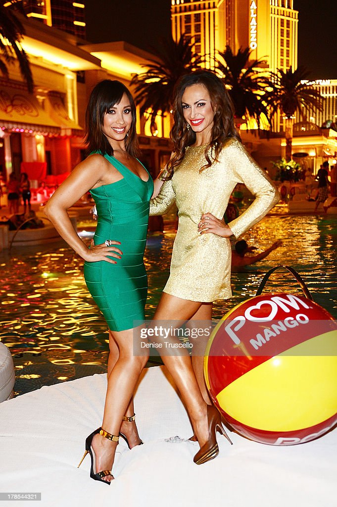 <a gi-track='captionPersonalityLinkClicked' href=/galleries/search?phrase=Cheryl+Burke&family=editorial&specificpeople=540289 ng-click='$event.stopPropagation()'>Cheryl Burke</a> and <a gi-track='captionPersonalityLinkClicked' href=/galleries/search?phrase=Karina+Smirnoff&family=editorial&specificpeople=4029232 ng-click='$event.stopPropagation()'>Karina Smirnoff</a> celebrate POM Wonderful's launch of three new 100% Juice Blends by leading 125 people in setting the Guinness World Record for the longest beach-ball bounce in history at the Encore Beach Club at Wynn Las Vegas on August 29, 2013 in Las Vegas, Nevada.